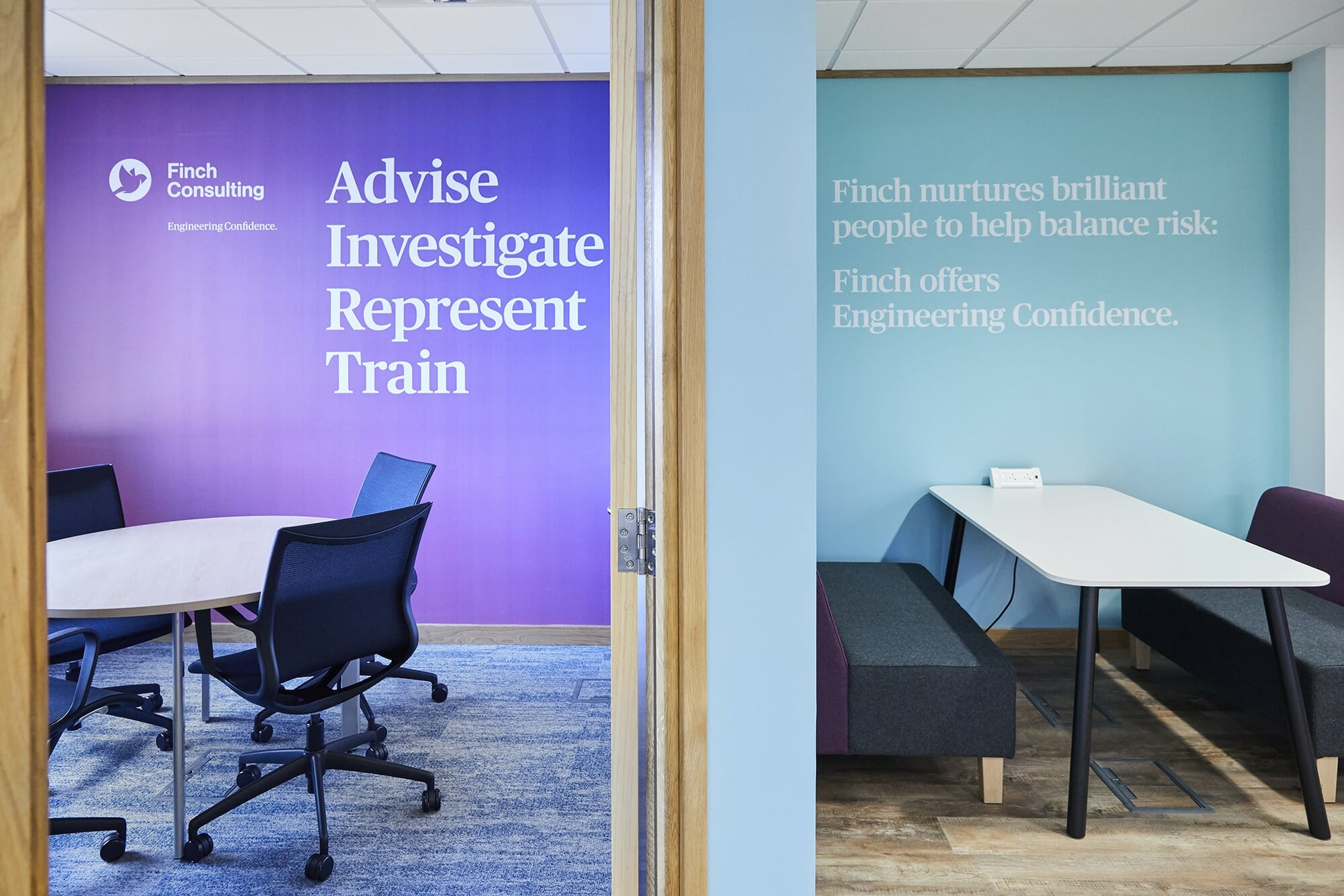 Finch Consulting commercial office design featuring company-branded wall graphics