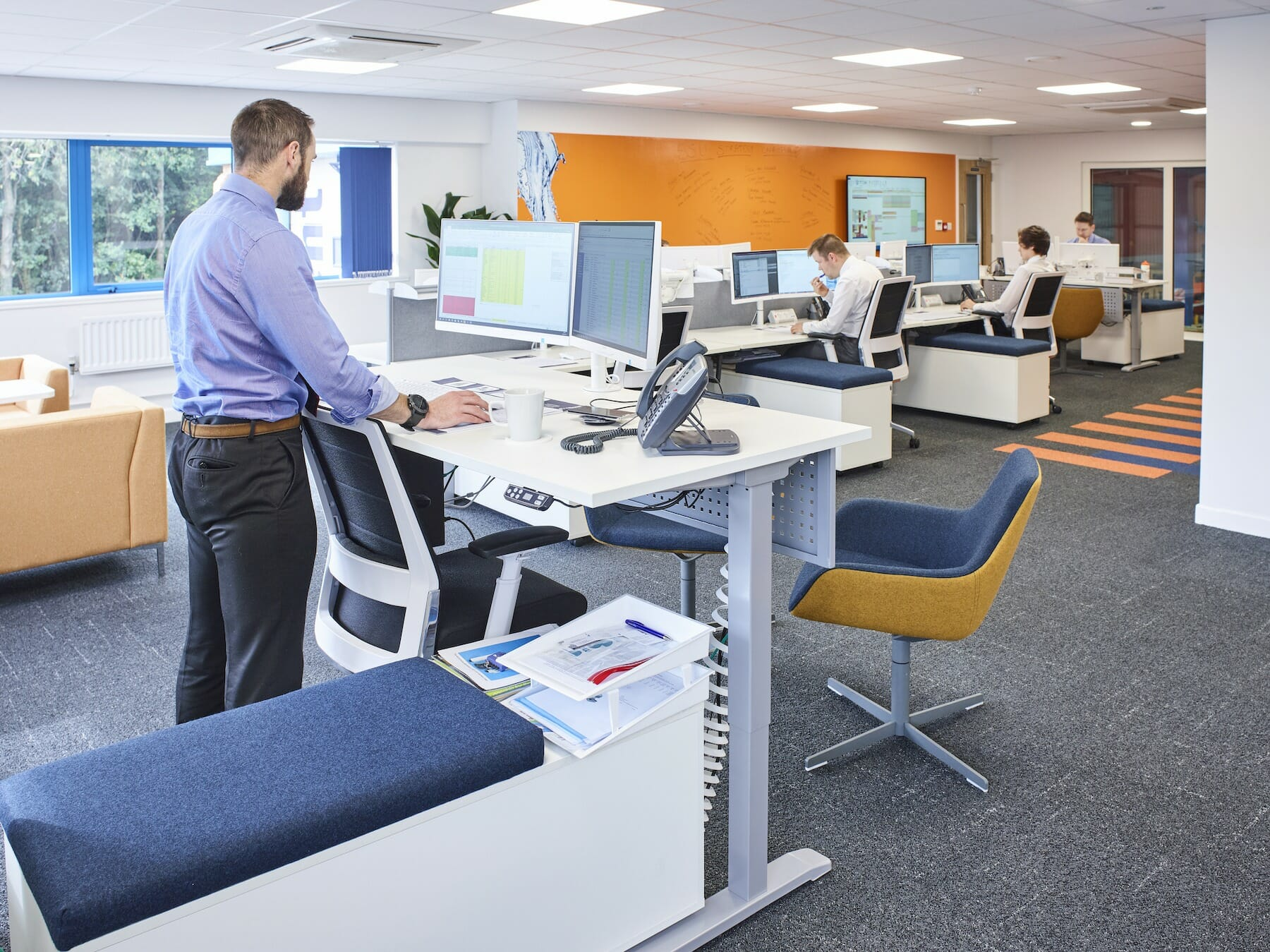 ProMinent commercial office design featuring a sit/stand desk